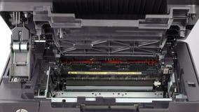 Cartridge replacement in laser printer stock footage