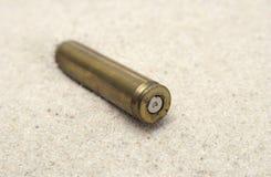 Cartridge on sand Stock Photos