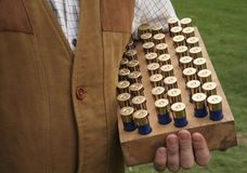 Cartridges. Shooter holds a tray of cartridges stock photos