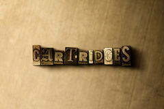CARTRIDGES - close-up of grungy vintage typeset word on metal backdrop Royalty Free Stock Photos