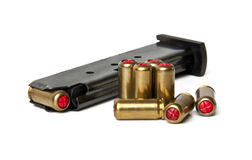 Cartridges and loaded magazine. On a white background Royalty Free Stock Photos