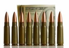 Cartridges and money - shallow DOF Stock Images