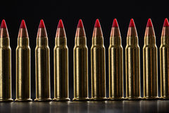 Cartridges ranked with red tip. On a black background Royalty Free Stock Image