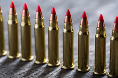 Cartridges ranked with red tip Stock Photography