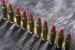 Cartridges ranked with red tip Stock Photos