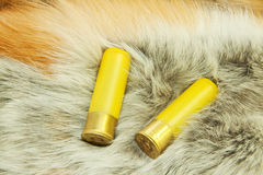 Cartridges on red fox fur Royalty Free Stock Photography