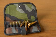 Cartridges rifle in pouch stock photo