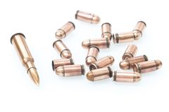 View of a riffle cartridge / isolated background. Cartridges and scales from various types of weapons Royalty Free Stock Images