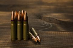 Cartridges to ak47. On a wooden table Royalty Free Stock Images