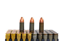 Cartridges to combat gun isolated Royalty Free Stock Images