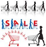 carts att shoppa för folkshoppare Arkivbild