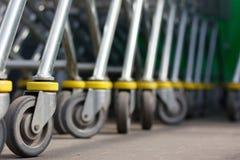 Carts. Closeup Shopping Carts Wheels Row Royalty Free Stock Images