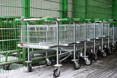 Carts for goods in store. Carts for goods in supermarket Royalty Free Stock Image