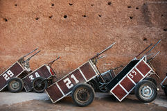 Carts with numbers Marrakech. Carts with numbers painted on the side leaning next to a wall Marrakech Royalty Free Stock Image