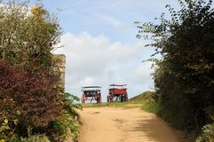 Carts parked on farm, Sark Stock Photography