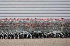 Carts at supermarket Stock Photos