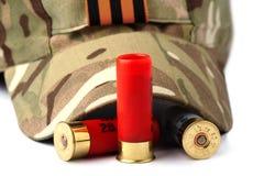 Cartuchos y casquillo de la escopeta Fotografía de archivo libre de regalías