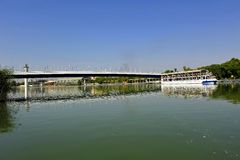 Cartuja bridge over the Guadalquivir River, Seville, Andalusia, Spain. One of the bridges that connect the two banks of the Guadalquivir river as it passes stock photography
