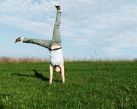 Cartwheel 2. Cartwheel in the nature,summer time,recreation,freedom Royalty Free Stock Photography