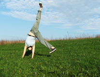 Cartwheel. In the nature,summer time,recreation,freedom Royalty Free Stock Photo