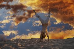 Cartwheel on beach. Cartwheel on the beach on sunset background Stock Photo