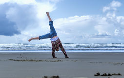 Cartwheel on the beach. Royalty Free Stock Image