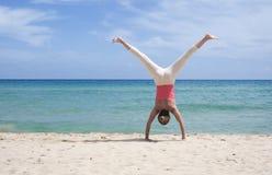 Cartwheel on the beach Stock Photos