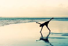Cartwheel della spiaggia Immagini Stock