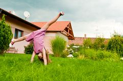 Cartwheel -fun on garden Royalty Free Stock Photography