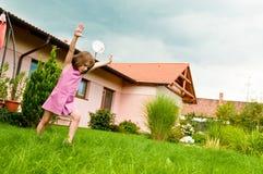 Cartwheel -fun on garden Stock Photos