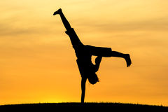 Cartwheel with one hand. Royalty Free Stock Images