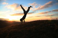 Cartwheel on sunset Royalty Free Stock Images