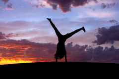 Cartwheel at sunset. Stock Photos