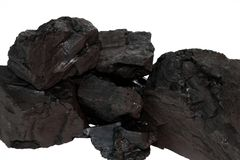 Carvão em um fundo branco Fotos de Stock