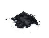 Carvão vegetal em um fundo branco fotos de stock