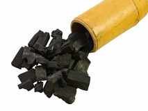 Carvão vegetal preto isolado no tubo de bambu Imagem de Stock Royalty Free