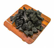 Carvão vegetal preto na placa de madeira Imagem de Stock Royalty Free
