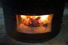 Carvões do fogo no fogão fotografia de stock royalty free