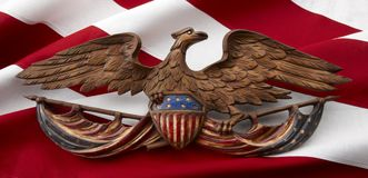 Carved American eagle on flag Royalty Free Stock Photo