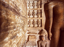 Carved architecture of India. Figurs of Jainism inside the 7th century cave temple, in town Badami, India Royalty Free Stock Photo