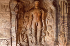 Carved Bahubali meditating, sculpture depicting hero of Jainism inside the 7th century cave temple, in Badami, India Stock Image