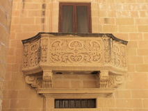 Carved Balcony. The stone balcony of Gozo's Museum of Archaeology which is housed in the17th century Town Hall Stock Photo