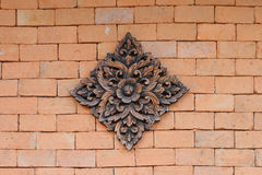Carved on brick background Stock Photography
