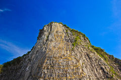 Carved buddha image on the cliff Stock Photography
