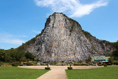 Carved buddha image on the cliff at Khao Chee Jan Royalty Free Stock Photos