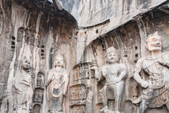 Carved Buddhist statues in the main Longmen Grotto Royalty Free Stock Photo