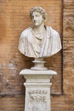 Carved Bust In Front of Brick Wall Royalty Free Stock Image