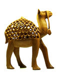 Carved camel statuette in wood Stock Photo
