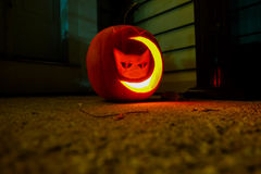 Carved cat and moon pumpkin. Carved pumpkin with cat and moon shaped lighted up Stock Photos