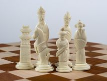 Carved Chinese Chess Set - White Pieces Stock Images
